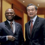 Chinese Foreign Minister Wang Yi, right, shares a light moment with his Sao Tome counterpart Urbino Botelho after a signing ceremony at the Diaoyutai State Guesthouse in Beijing, Monday, Dec. 26, 2016. China and Sao Tome and Principe officially resumed diplomatic relations on Monday, in a triumph for Beijing over rival Taiwan after the African island nation abruptly broke away from the self-ruled island last week. (AP Photo/Andy Wong)